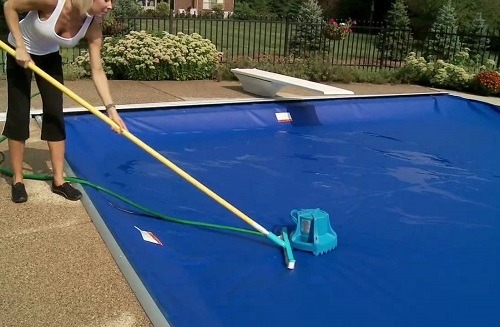Woman Washing Pool Cover