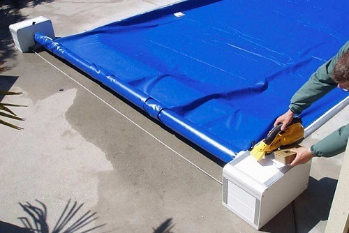 Man Using Pool Cover