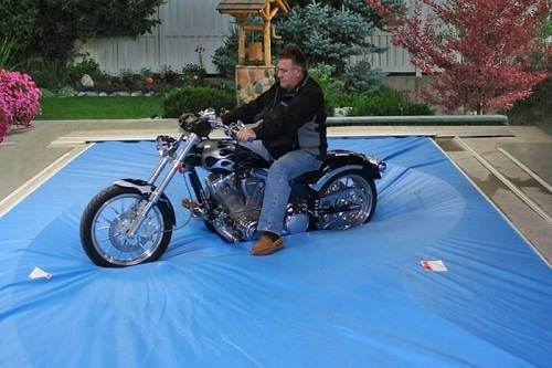 Man With Bike On Pool Cover